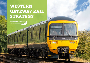 Front cover of the rail strategy brochure with a train